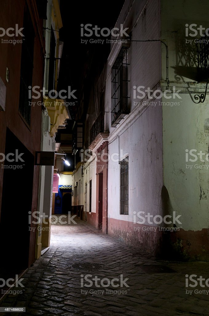 Dark Alleyway in Santa Cruz district of Seville stock photo