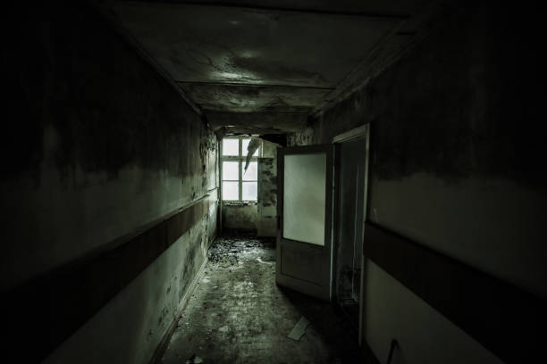 dark and creepy corridor of abandoned building - город призрак стоковые фото и изображения