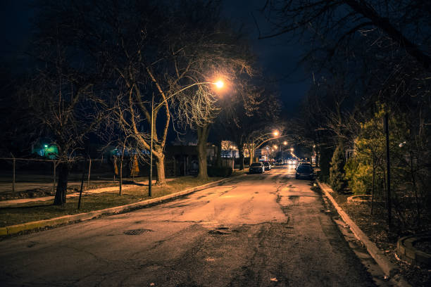 Dark and eerie urban city street at night stock photo