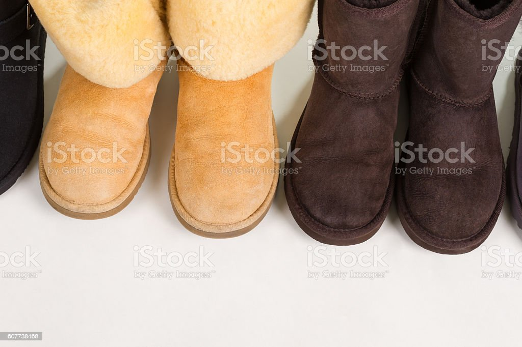 Dark And Light Winter Boots On A White Background Stockfoto