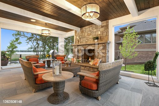 istock Dark and white wood ceiling over patio of new home 1262508148