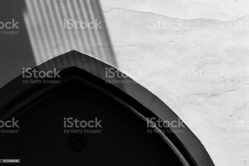 Dark arch with shadows stock photo