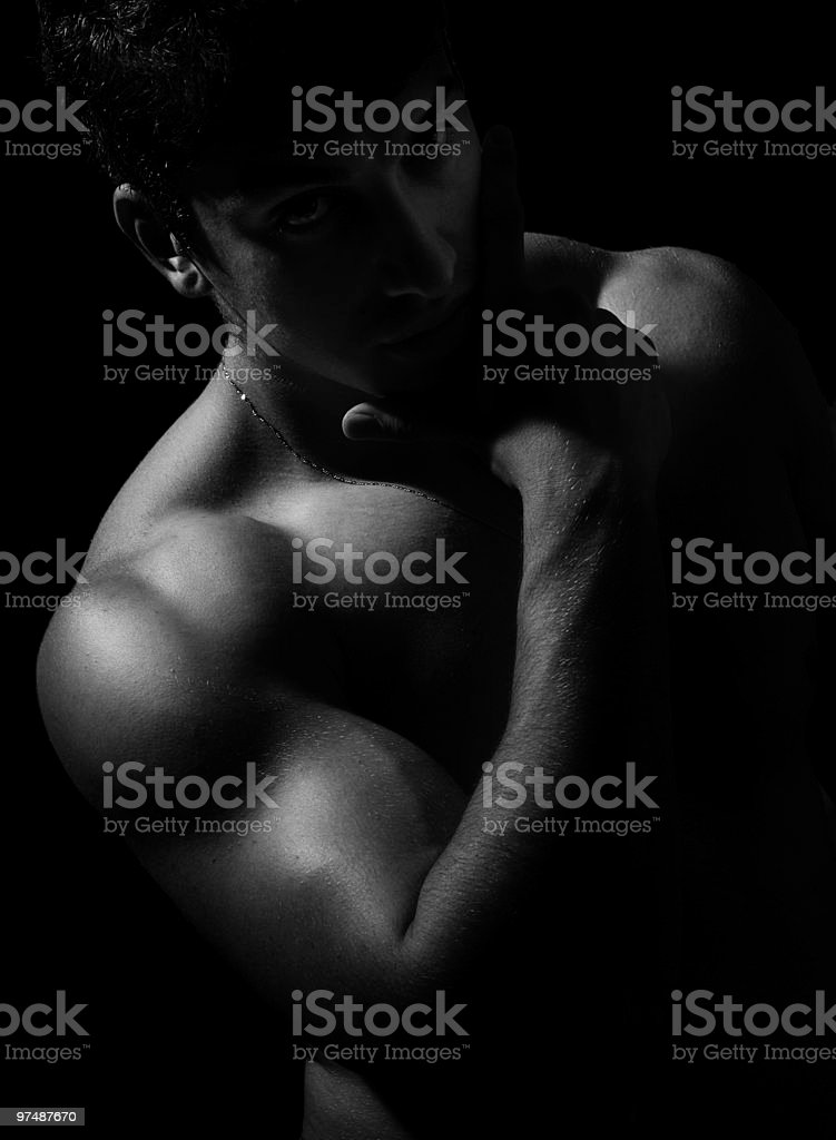 Dark artistic portrait of sexy muscular naked man royalty-free stock photo