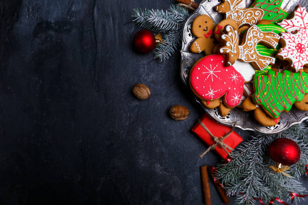 dark background and with a layout in the corner of a christmas cookie. view from above. - holiday foto e immagini stock