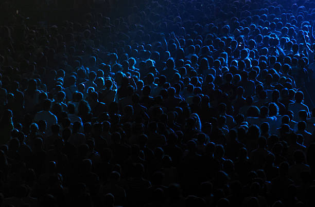 Dark background of crowd at concert stock photo