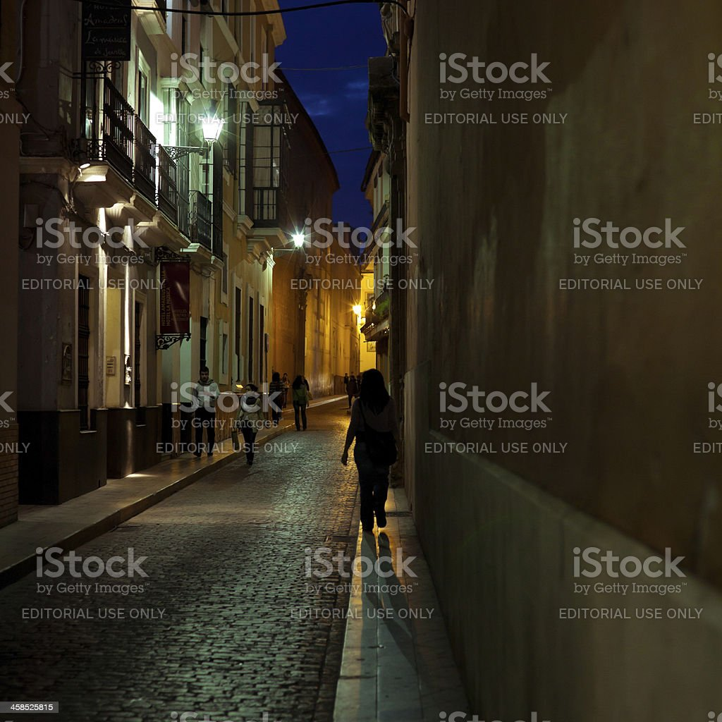 Dark Backstreet at Night in Seville, Spain royalty-free stock photo