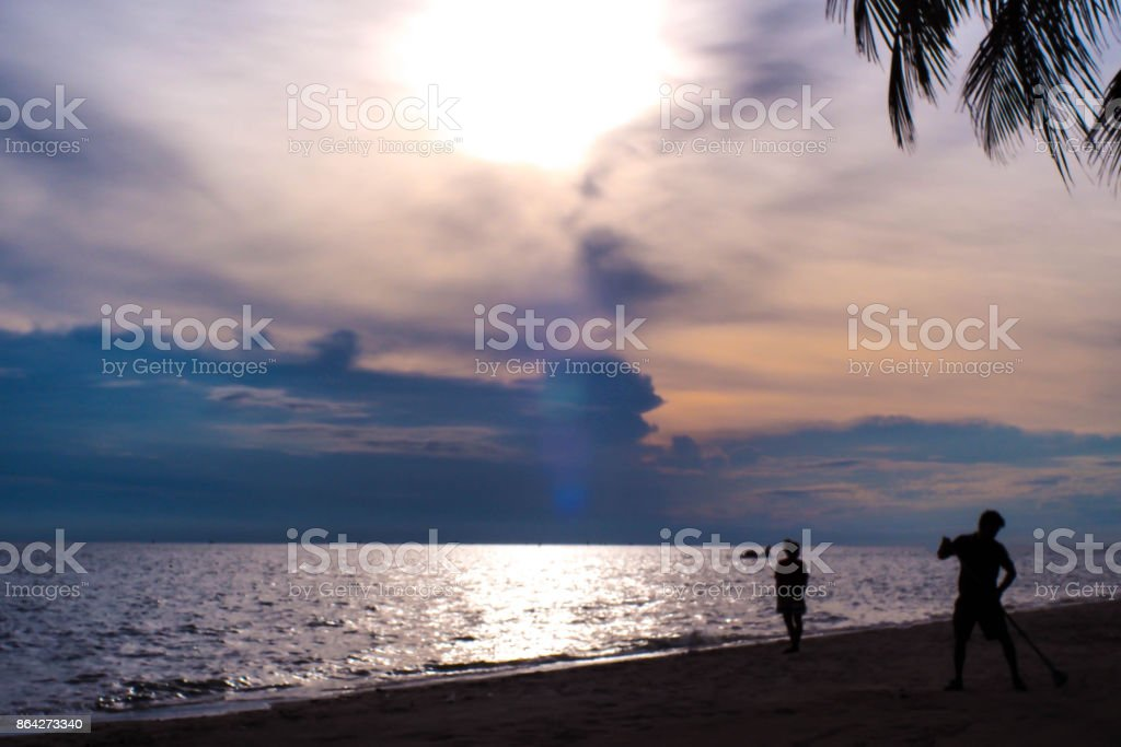 Dark beach with two silhouette people. royalty-free stock photo