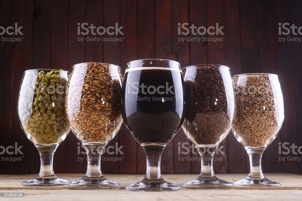 Dark beer and ingredients stock photo