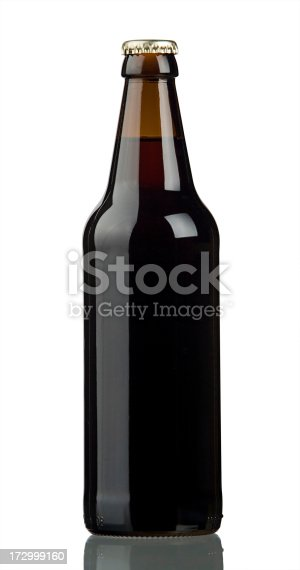 bottle of dark beer isolated on a white background with a clipping path