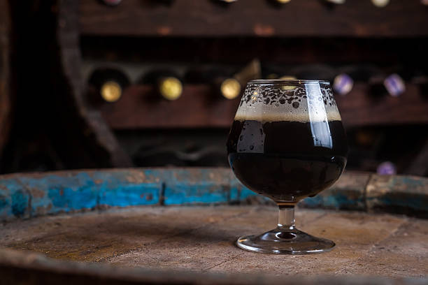 dark beer in a cellar - dark beer stock photos and pictures