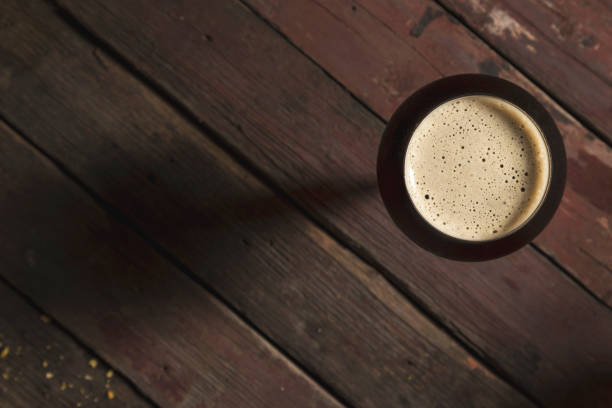 dark beer in a glass - dark beer stock photos and pictures