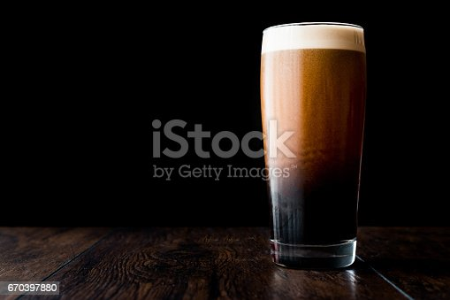 istock Dark beer on wooden surface. copy space. 670397880