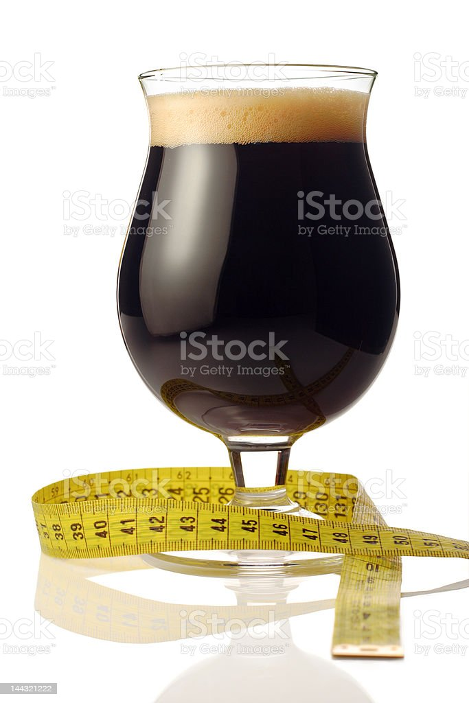 Dark beer with a measuring tape royalty-free stock photo