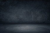 Dark black and blue grungy wall background for display or montage of product
