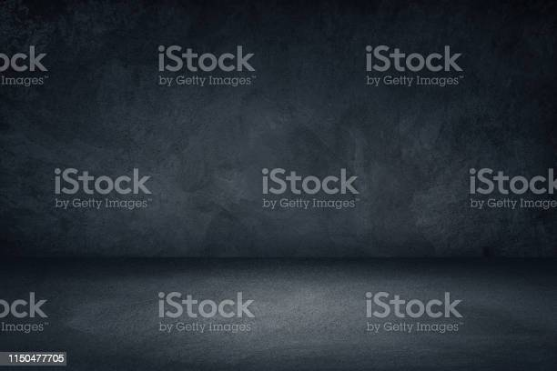 Photo of Dark black and blue grungy wall background for display or montage of product