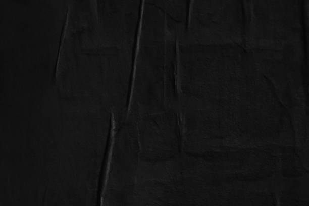 Dark black blank paper backgrounds creased crumpled surface old torn ripped posters grunge textures placard stock photo
