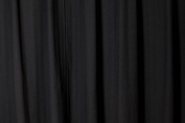 dark black curtain folded at a theater - photography curtains stockfoto's en -beelden