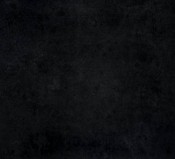 Dark black grunge backdrop. Surface, background and wallpaper stock photo