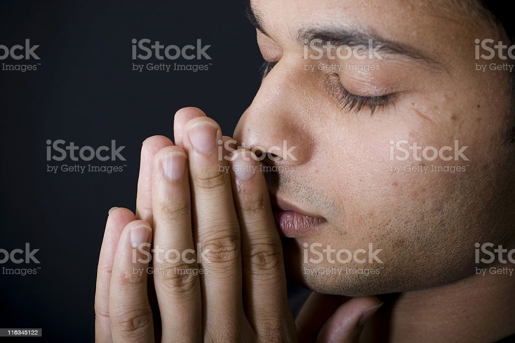 Dark Black Portrait of One Indian Youth Man Male Praying stock photo