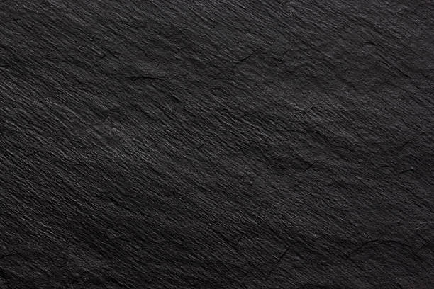 dark black slate background or texture - pizarra roca metamórfica fotografías e imágenes de stock
