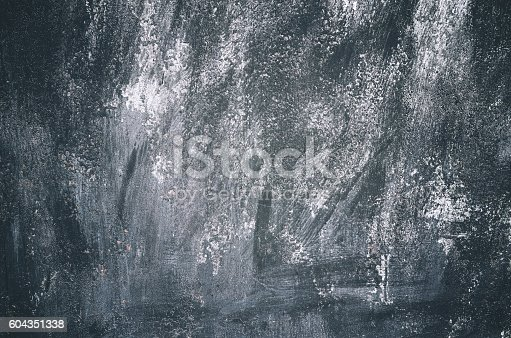 istock Dark black white grunge old wall texture background 604351338