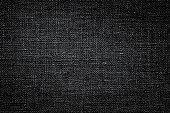 istock Dark black white linen canvas. The background image, texture. 1096047636