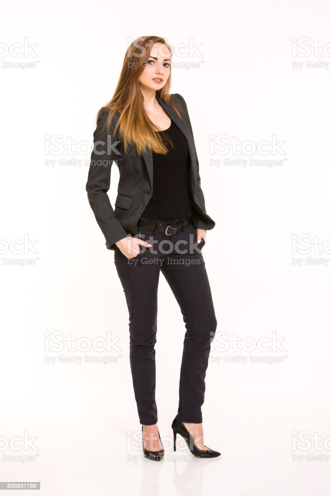 da278a0986cd Dark blonde woman wearing smart casual outfit with hands in the pockets -  Stock image .