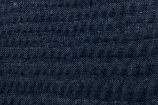 Dark blue background from a textile material. Fabric with natural texture. Backdrop. stock photo