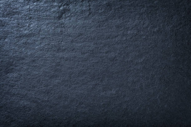 dark blue background of natural slate. texture of stone - solidità foto e immagini stock