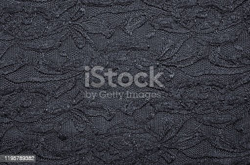 istock dark blue black Lace with floral texture 1195789382