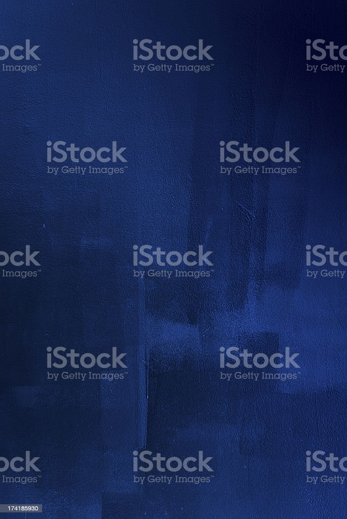 Dark blue brush strokes on wall stock photo