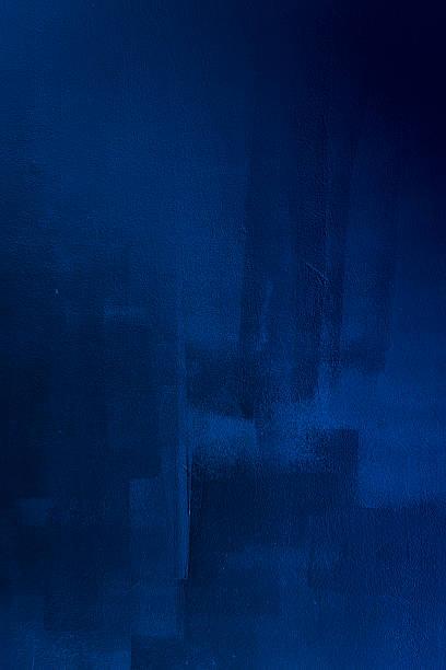 Dark blue brush strokes on wall stock photo