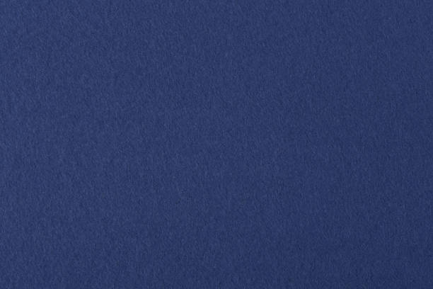 dark blue colored felt texture background on macro - felt textile stock pictures, royalty-free photos & images