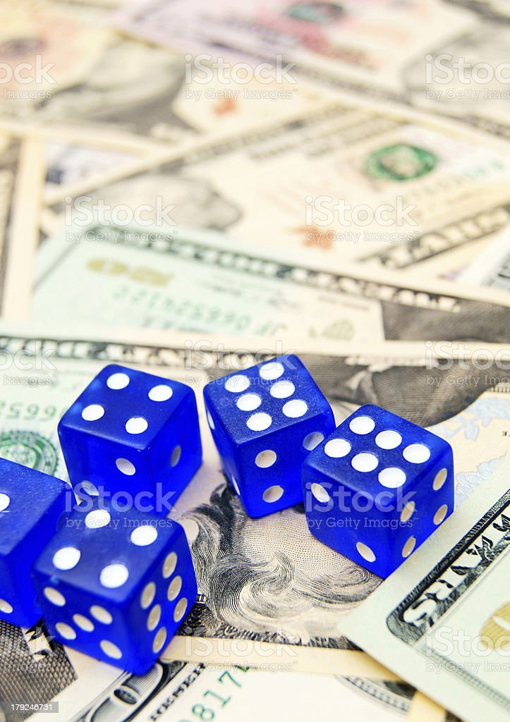 Dark blue dices and dollars. royalty-free stock photo