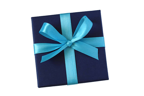 Dark blue gift box with ribbon bow Dark blue gift box with light blue bow - top view - isolated on white background gift box stock pictures, royalty-free photos & images