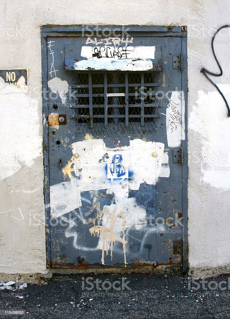 Dark Blue Graffiti Covered Door royalty-free stock photo