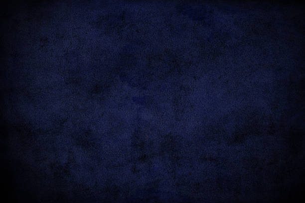 Dark blue grunge background Close up on cement plaster wall surface, blue colored and vignetted by Photoshop. dark blue stock pictures, royalty-free photos & images