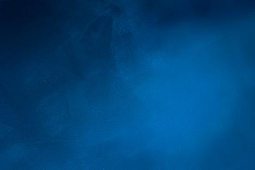 Dark blue grunge background.