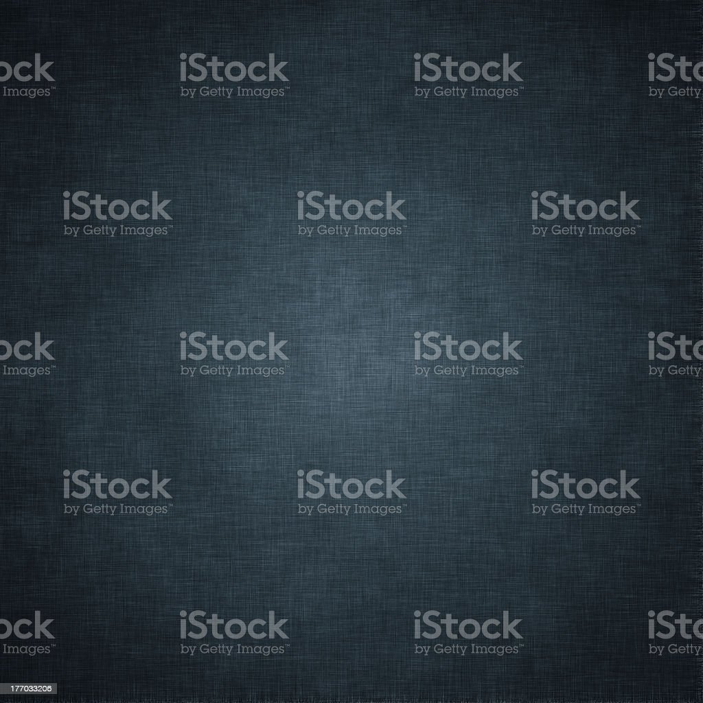A dark blue grungy vintage textile background stock photo