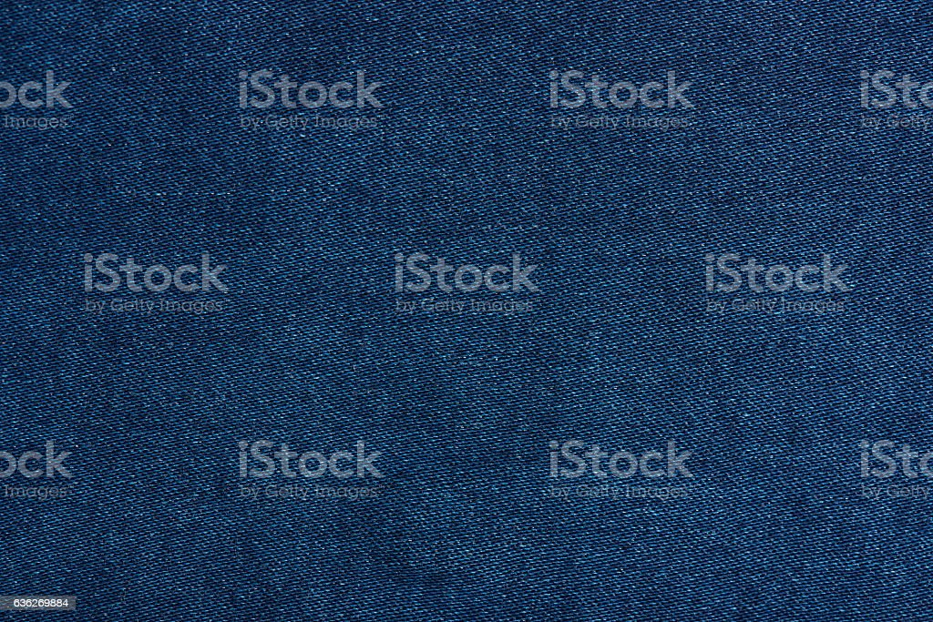 Dark blue jeans texture close up stock photo