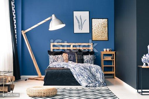 istock Dark blue master bedroom 840802596