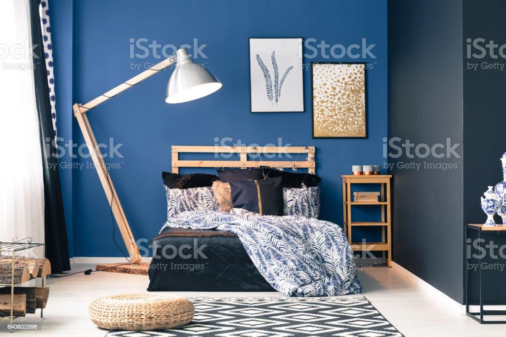 Dark blue master bedroom stock photo