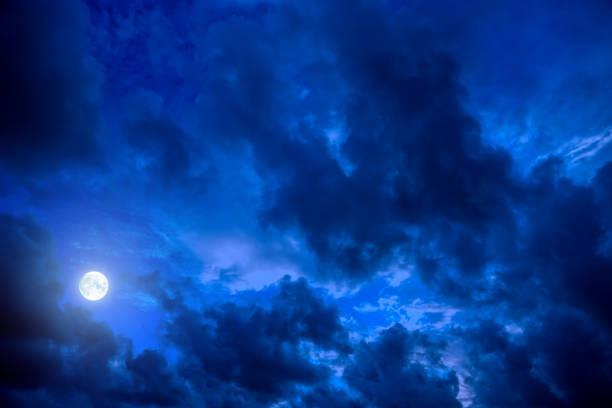 dark blue night sky with full moon stock photo
