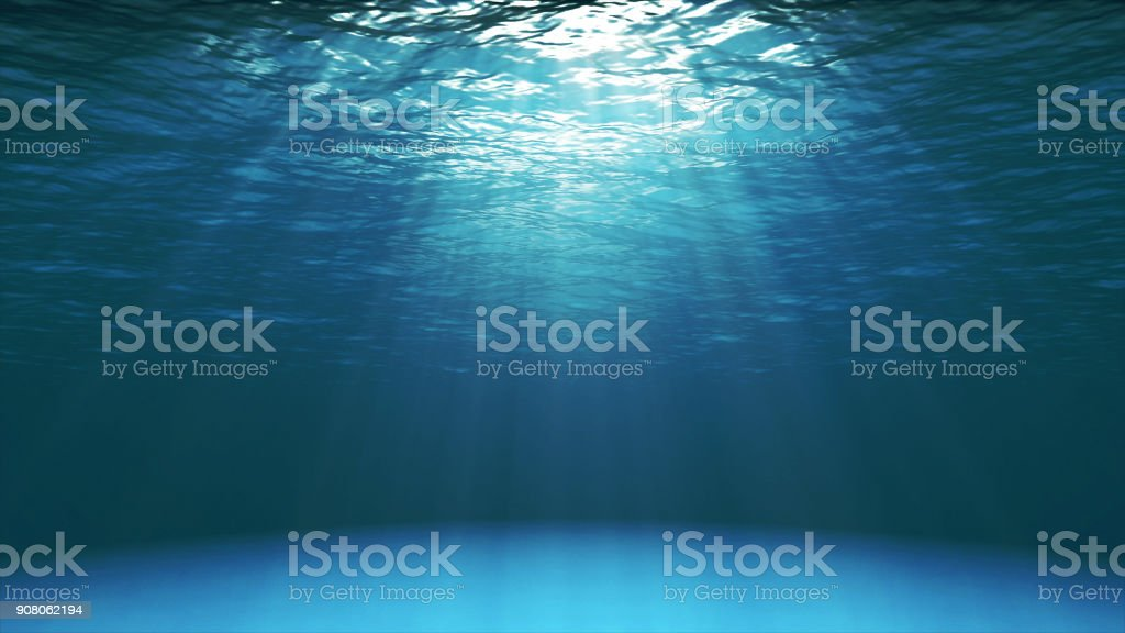 Dark blue ocean surface seen from underwater stock photo