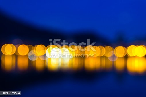 Dark blue screen background with blurred yellow lights in Rio de Janeiro.