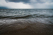 Dark blue sky and waves on lake before storm. Baikal,Russia