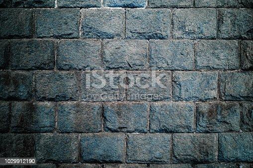 dark blue stone wall
