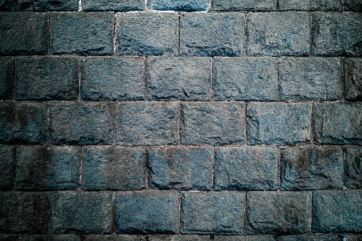 dark blue stone wall