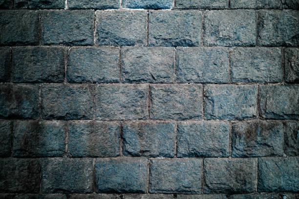 koyu mavi taş duvar - ortaçağ stok fotoğraflar ve resimler