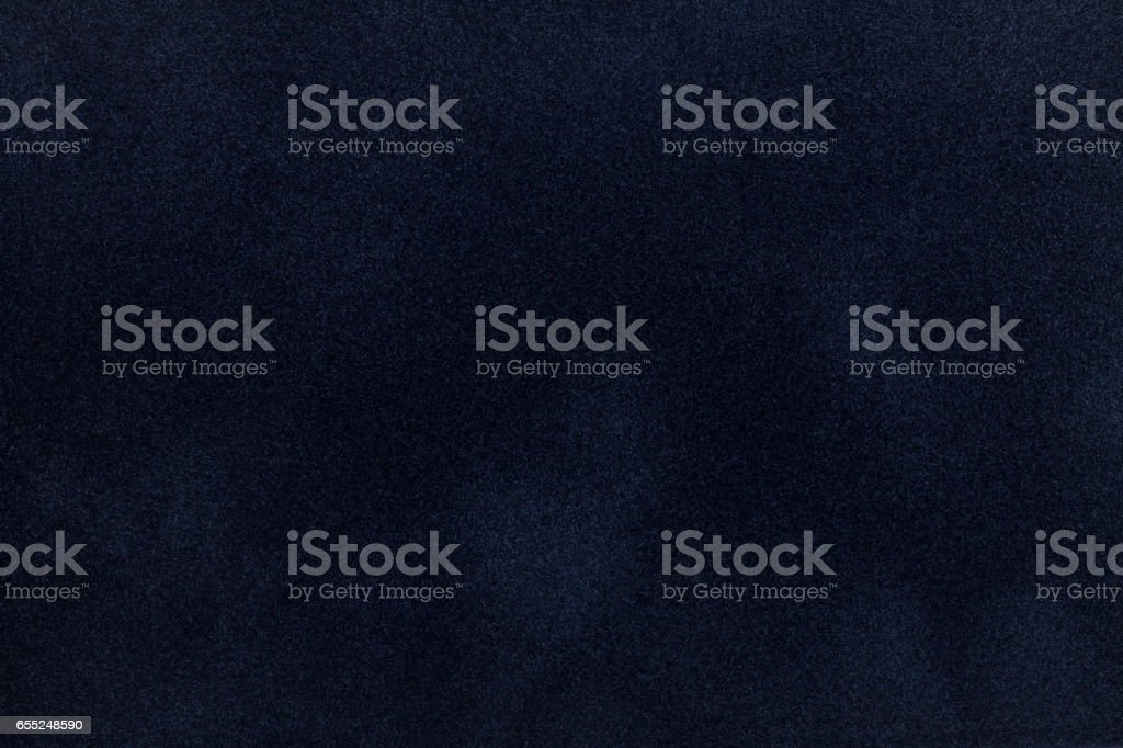 Dark blue suede fabric closeup. Velvet texture. stock photo